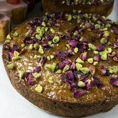 Pistachio and rose water semolina cake to celebrate the royal wedding. Making this cake is a labour of love, but that's only appropriate, we think, for a cake adorned with rose petals. Recipe is in the Sweet cookbook. Semolina Cake, Dessert Cookbooks, Yotam Ottolenghi, Rose Water, Rose Petals, Pistachio, Sweet Recipes, Spices, Yummy Food