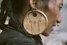 Details of the earring worn traditionally by the Tamang women, Himalayan regions of Tibet, Nepal and India.~
