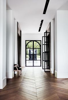 A muted palette of alternating black and white rooms lends a pleasing rhythm to this sophisticated Melbourne home with French and Belgian influence. - October 12 2019 at Apartment Door, Design Apartment, Floor Design, House Design, Decor Interior Design, Interior Decorating, Decorating Games, Design Scandinavian, Living Room Wood Floor