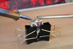 Holding glass slide pendant with Binder Clips while soldering - could use for clamp to hold any small item while gluing