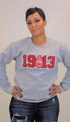 DST Chenille 1913 with Crest Crew Neck Sweatshirt – J Mar Greek Life Source by Delta Sigma Theta Apparel, Sigma Gamma Rho, Pullover, Crew Neck Sweatshirt, Delta Girl, Gothic Lolita Fashion, Punk Fashion, Social Trends, Camo Hoodie