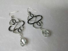 Avon Open Loop Tear drop pierced earrings Mint Condition Silvery Drama