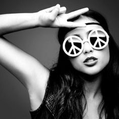 Natalia Kills in peace sunglasses