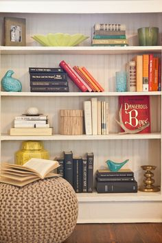 I think a low profile basic shelf like this would be perfect on your short wall in the bedroom between the hallway ans closet doors. Could be white, dark or warm wood tone - with collected items and books.