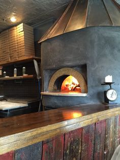 Dough Artisan Pizzeria - Caldwell, NJ, United States. Brick oven pizzas. Beautiful interior and outdoor seating. Rustic and toasty!