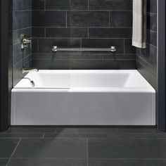 KOHLER Bellwether W x L White Cast Iron Rectangular Left-Hand Drain Alcove Bathtub at Lowe's. The updated, clean lines of the Bellwether bath coordinate with a variety of products. Made of KOHLER Cast Iron, it incorporates an integral apron and Deep Soaking Bathtub, Soaking Bathtubs, Small Soaking Tub, Square Bathtub, Modern Bathtub, Modern Bathroom, Mini Bad, Cast Iron Tub, Bathrooms