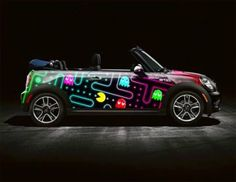 """Pac-man"" inspired convertible Mini Cooper art car by designer Matt W. Moore. | Image via www.facebook.com/WurldzOfAhrt."
