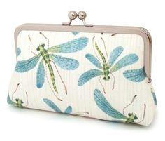 This contemporary clutch bag features a beautiful dragonfly print by Etsy artist Golly Bard. Printed onto 100% cotton, the fabric features teal, turquoise and green dragonflies against a lightly striped ivory background. Lined in teal dupion silk. $75.00