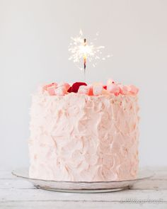 This Turkish Delight layer cake is beautiful! Pretty pink frosted cake topped with a Sparkler Candle...simply elegant!