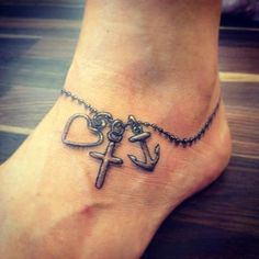 An anklet anchor tattoo. The anklet tattoo shows two other objects other than the anchor which is the heart shape and a cross which means that these three symbols have an impact in the person's life collectively.
