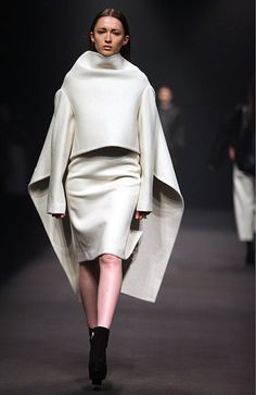 Sculptural fashion construction - clean, minimal tailoring with an exaggerated 3D silhouette // Qui Hao
