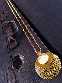 Natanè Planet necklace cream color on Castello Sforzesco old door in Milan . #necklace #collane #colors #beige #woman #fashion #style #outfit #swarovski #jewel #bijoux #door #porta #gate #girl #natanè