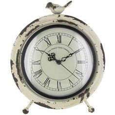 Add old world charm to desk, table or other work station decor with this antique white metal table clock with a bird on top!