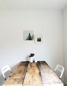 Kitchen table. Bench on one side, cushion chairs with arms on each end, and cushion armless chairs on the other side.
