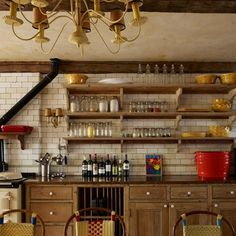 See all our stylish kitchen design ideas. Keith McNally's pine kitchen with antique industrial tiles.
