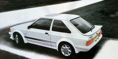 1985 Ford Escort RS Turbo S1. Original advertisement from car magazines of the time when it was launched.