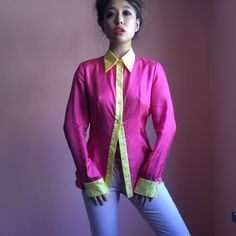 Prada Silk Colorblock Button Up Blouse Brighten up with this editorially fantastic Prada button up blouse. Features a sharp collar, contrast colorblock in raspberry pink and sunshine yellow. Wear tucked into a high waist pencil skirt to complete that Prada look. MSRP $550. Fits true to Italian 40, like a US 4. Missing one button. No returns allowed. Please ask all questions before buying. IG: [at] jacqueline.pak #prada Prada Tops Blouses