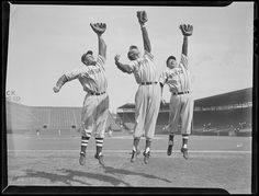 1940 (approximate) Boston Red Sox Bobby Doerr, Boston Red Sox Ted Williams, and Boston Red Sox Dom DiMaggio show their reach at Fenway Park.