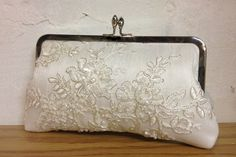 Tru Luv's Lace & Pearl Bridal Clutch (Ivory). $60.00, via Etsy.