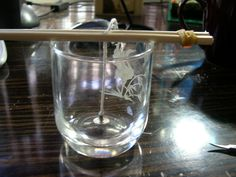 candle making, neat wick holding device.