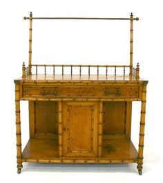 American Victorian Faux Bamboo Washstand by RJ Horner. Rare Aesthetic Movement Stand with Gallery Top and Towel Rack above One Drawer and Central Door Compartment with Open Ends. RJ Horner, New York. Circa 1890.