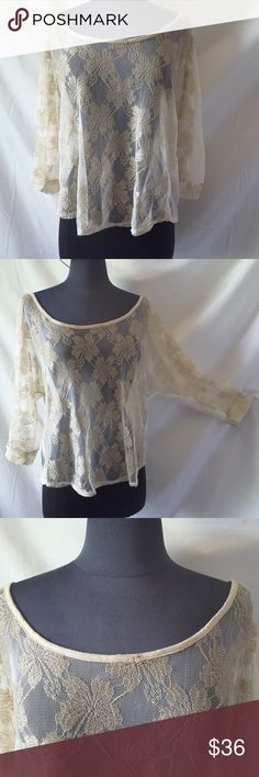 """Threads Lace Backless Dolman Sleeves Top Large This beautiful lace top is in great condition with the exception of a small spot right on the neckline.  (See photo) It is cream with metallic gold lace. Chest: 20"""" Front Length from shoulder to hem: 20"""" 60% metallic  40% Nylon   My home is smoke-free and pet-free.  Check out the other items in my closet and bundle two or more items for a great bundle discount.  I consider all offers.  Happy POSHING! Threads Tops"""