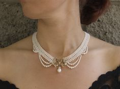 "white woven pearl necklace with ""drapes"" ,by Marina J"