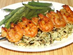 The addition of spicy shrimp to fettuccine alfredo turns basic alfredo into a hearty meal. Spicy Shrimp Alfredo is a great weeknight family meal. Grilling Recipes, Cooking Recipes, Spicy Grilled Shrimp, Asian Grill, My Recipes, Favorite Recipes, Shrimp Skewers, Thing 1, Family Meals