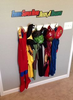 My sons super hero bedroom, homemade signage for his capes. By KatieGillespie.com
