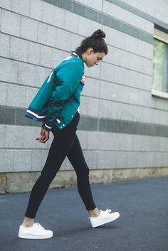 Varsity jacket + white shirt + black jeans + white sneakers