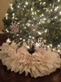 Beautiful Christmas Tree Skirt in a Creamy/White color. SO full and it has SO many ruffles!! 4 gorgeous layers!!! It will take your