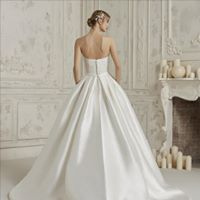 Image may contain: 1 person Designer Wedding Dresses, Wedding Gowns, Wedding Day, Showroom, One Shoulder Wedding Dress, That Look, Bride, Unique, Lace