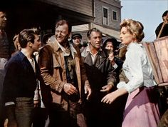 Capucine & John Wayne