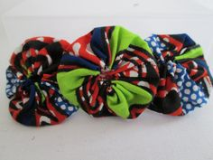 African fabric yoyo flower hair barrette by MildredsClosetUK, £3.00