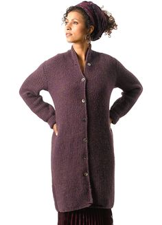 "Our stunning seed stitch sweater coat has an interesting button band and flattering high neck. Shown in size Small   Sizes Directions are for women's size X-Small.  Changes for sizes Small, Medium, Large and X-Large are in parentheses.   Finished Measurements Bust (closed) – 36(40-44-48-52)"" Length – 40""   Materials 11(11-13-14-15) hanks Berroco Ultra Alpaca (100 grs), #5984 Prune Mix Straight knitting needles, size 8 OR SIZE TO OBTAIN GAUGE"