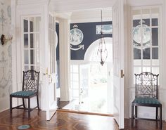 Regency-fab by Anthony Baratta. The inlaid floor, the series of inner French doors, the scenic plasterwork rondells reminiscent of Wedgewood china — love.