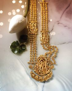 Gorgeous rani haar or statement necklace with pendant by Tanishq. Gold jewellery.