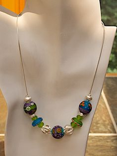 Thisnecklace & earrings set made possible thanks to stunning artisan glass lampwork beads by Donna Millard Art Glass.  Thai silver beads, sterling silver Omega chain and ear wires.  Necklace & Earrings designed by Joann Hayssen Designs SRA  $180.00 https://www.etsy.com/listing/202471748/etched-lampwork-glass-necklace-earrings?ref=shop_home_active_1
