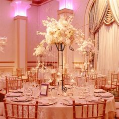 Unique Tall Centerpieces with votive balls hanging on strings of glass beads
