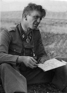 Kurt Meyer,in the field. ~ A great German tank commander but in Canada he will always be known as the son-of-bitch who had his men murder and mutilate at least 30 Canadian soldiers. Check this out... http://grad.usask.ca/gateway/archive9.html