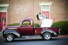 Vintage 40's Wedding with GMC truck with bride and groom kissing in the back....look at the red shoes!