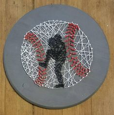Baseball (Pitcher) String Art -Grey Wood Background -Hand Strung Thread -Size is approximately 9x12 -Hanger on Back Have an Idea of something you would like but dont see it in my shop? Message me and wee can work to create your piece. I am always open to new creative ideas.
