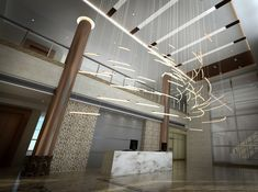This design uses blown glass tubes, lit from within, to create a dynamic, fast-moving effect. This design can be configured for small and large spaces depending on the number of glass elements. Ideal as a strong focal point for entrance areas, lobbies, and foyers.