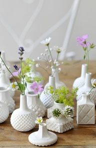 Mini porcelain vases for mini flowers....perfect to create a casual table cluster in the home.