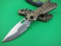 Strider - Hunting Folding Utility Knife Tactical 61-62hrc D2 Steel Titanium Alloy Handle by STRIDER, http://www.amazon.com/dp/B00CY0YFSC/ref=cm_sw_r_pi_dp_rZhRrb1WJPD0W