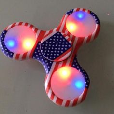 US Flag LED Light Up Fidget Spinner Buy Now: https://www.fromouttathisworld.com/products/us-flag-led-light-up-fidget-spinner