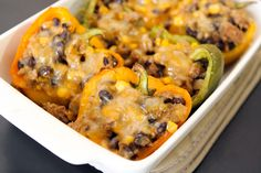 Corn and Black Bean Stuffed Peppers Ingredients: 1/2 pound ground turkey, 1/2 large onion, 1 cup black beans, 1 cup frozen corn, 1 tbsp. taco seasoning (or sub for no wheat seasonings), 3 large bell peppers, 1 cup of shredded cheese (Monterrey jack)- only no turkey for me