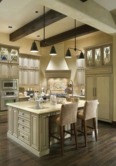 I love the dark beams with ivory cabinetry...needs dark countertops though - Elegant looking...sleek