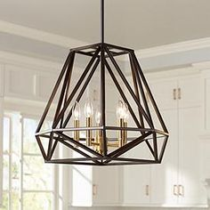 Hawking Wide Bronze Pendant Chandelier Surrounded by an open geometric frame, this stylish metal pendant chandelier will put the finish touch in any room in your home. Candelabra style lights inside enhance the vintage-industrial style look. Chandelier Lighting Fixtures, Foyer Chandelier, Dining Room Light Fixtures, Kitchen Chandelier, Kitchen Lighting Fixtures, Kitchen Pendant Lighting, Kitchen Pendants, Light Pendant, Geometric Pendant Light