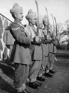 Malindine E G (Lt) -- Mule handlers of the Royal Indian Army Service Corps parade with drawn swords, 16 November 1940. -- High quality art prints, canvases -- Imperial War Museum Prints